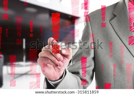 Businessman drawing a red exclamation mark. Business concept. - stock photo