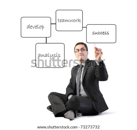 Businessman drawing a strategy scheme - stock photo