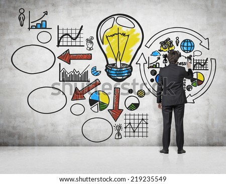 Businessman drawing a wall's flow chart. A concept of start up business project.  - stock photo