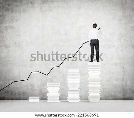 Businessman drawing an increasing graph. A concept of business growth.  - stock photo