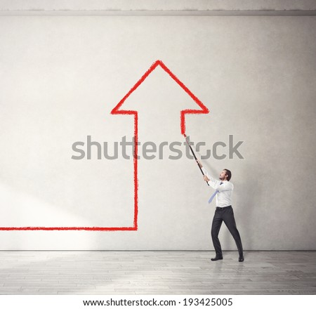 Businessman drawing arrow up - stock photo