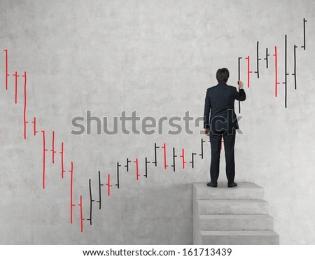 Businessman drawing bars. - stock photo