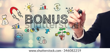 Businessman drawing Bonus concept on blurred abstract background