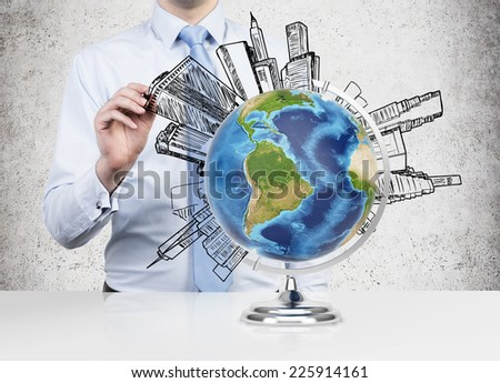 Businessman drawing buildings around the world (Latin America views). Elements of this image furnished by NASA  - stock photo