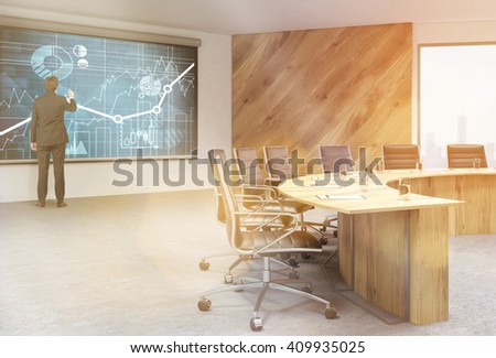 Businessman drawing business charts on blackboard in conference room interior. Toned image. 3D Rendering - stock photo