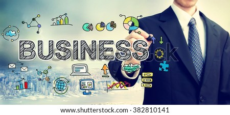 Businessman drawing Business concept above the city - stock photo