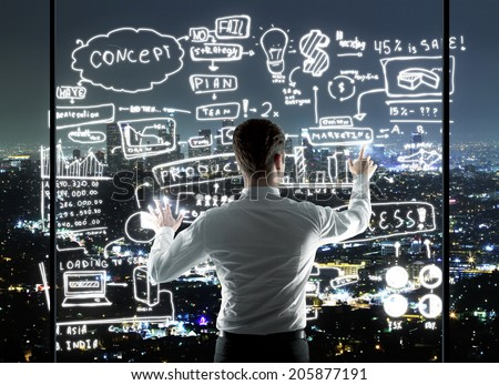 businessman drawing business concept in night office - stock photo