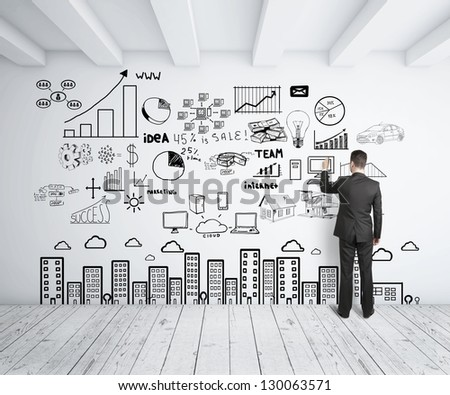 businessman drawing business concept on wall - stock photo