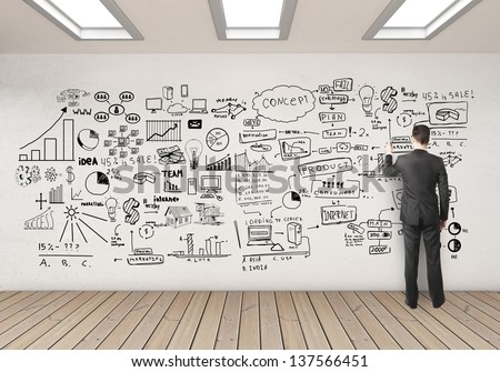 businessman drawing business concept on white wall - stock photo