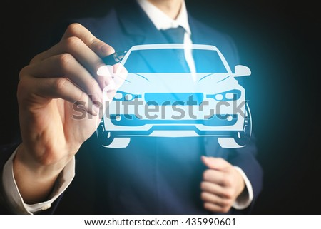 Businessman drawing car on virtual screen