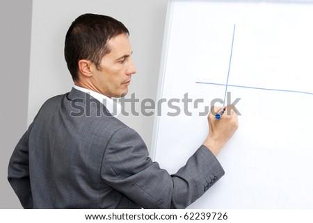 Businessman drawing chart - stock photo