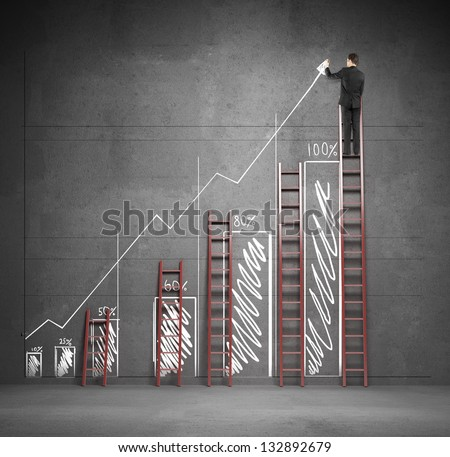 businessman drawing chart with three ladders - stock photo