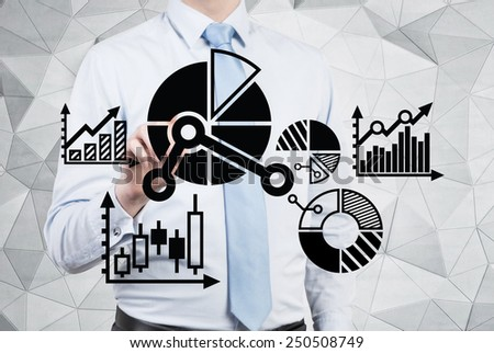 businessman drawing charts and graphs - stock photo