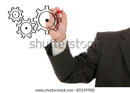 Businessman drawing cogwheels - stock photo