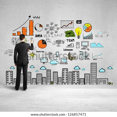 businessman drawing colorized city concept - stock photo