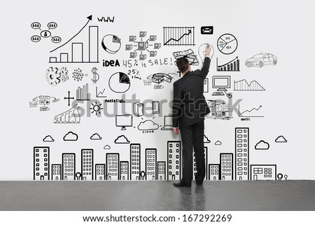 businessman  drawing concept city on wall - stock photo