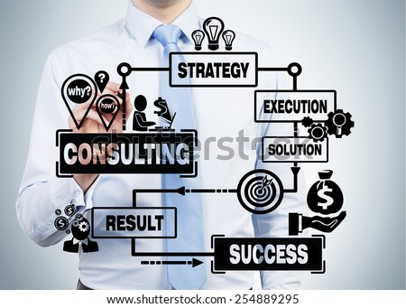 businessman drawing consulting scheme on gray background - stock photo