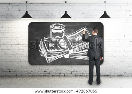 Businessman drawing creative money sketch on chalkboard in white brick interior. 3D Rendering