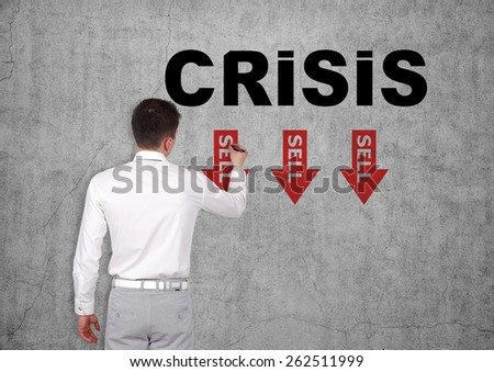 businessman drawing crisis concept on concrete wall - stock photo
