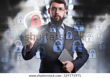 Businessman drawing  cyber security concept on the virtual screen. Business, internet and technology concept. - stock photo