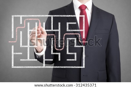 Businessman drawing diagram with chalk  - stock photo