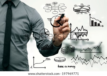 businessman drawing different graphs, charts and business elements - stock photo