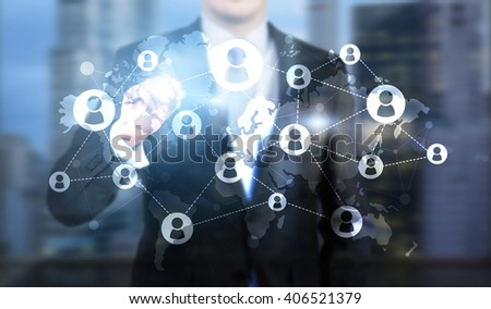 Businessman drawing digital networking system on abstract blue background - stock photo