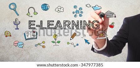 Businessman drawing  E-Learning concept with a marker - stock photo