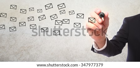 Businessman drawing envelope sketch with a marker - stock photo