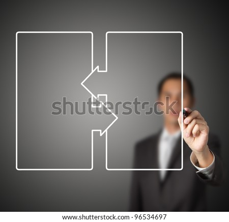 businessman drawing  exchange diagram of two blank square blocks - stock photo