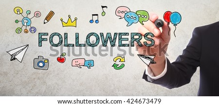 Businessman drawing Followers concept with a marker - stock photo