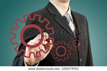 Businessman drawing gear to success - stock photo