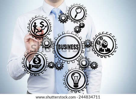 businessman drawing gears with business icons - stock photo