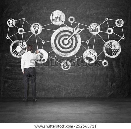 businessman drawing goal concept on wall - stock photo
