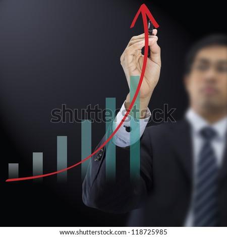 Businessman drawing graph - stock photo