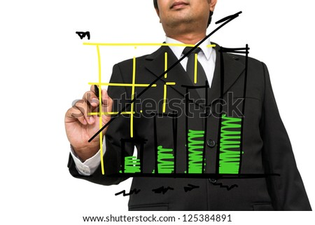 Businessman drawing  graph on the board - stock photo