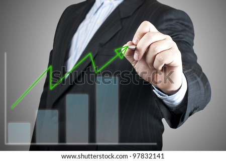Businessman drawing graph on the screen. Concept for business growth