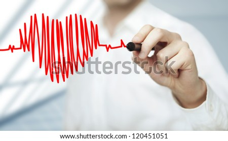 businessman drawing heart and chart heartbeat - stock photo