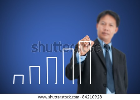 Businessman drawing in a whiteboard - stock photo