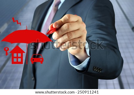 Businessman   drawing insurance concept by  a red pen  - stock photo