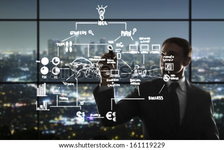 businessman drawing interface in night office - stock photo