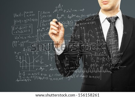 businessman drawing mathematical formulas on a gray background