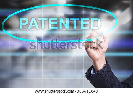 """Businessman drawing on virtuak screen text """"Patented"""". Business concept. Internet concept. - stock photo"""