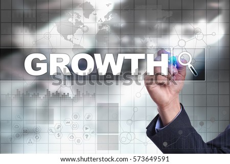 Businessman drawing on virtual screen. growth concept.
