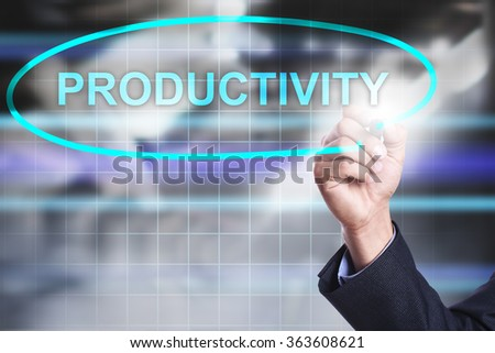 "Businessman drawing on virtual screen text ""Productivity"". Business concept. Internet concept. - stock photo"