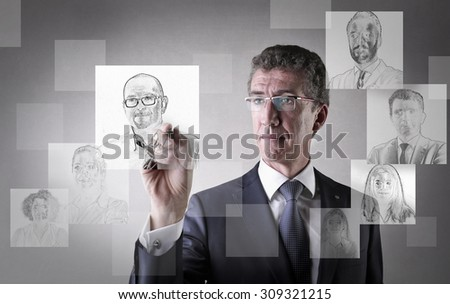 Businessman drawing profiles - stock photo