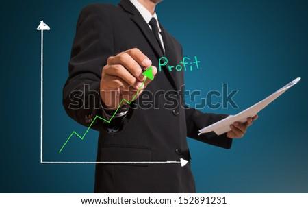 businessman drawing profit draph - stock photo