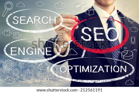 Businessman drawing SEO concept bubbles with cartoon - stock photo