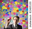 Businessman drawing some colored circles - stock photo