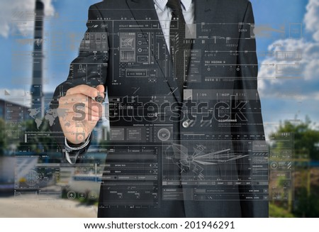 businessman drawing some graphs and sketches in the background is a factory landscape - stock photo